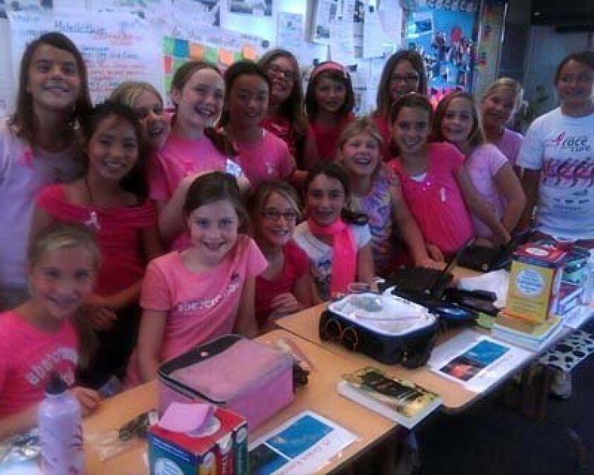 Fifth graders from Rooms B-8 and B-10 show their support for the fight against breast cancer. Photo: Ginny LaRowe