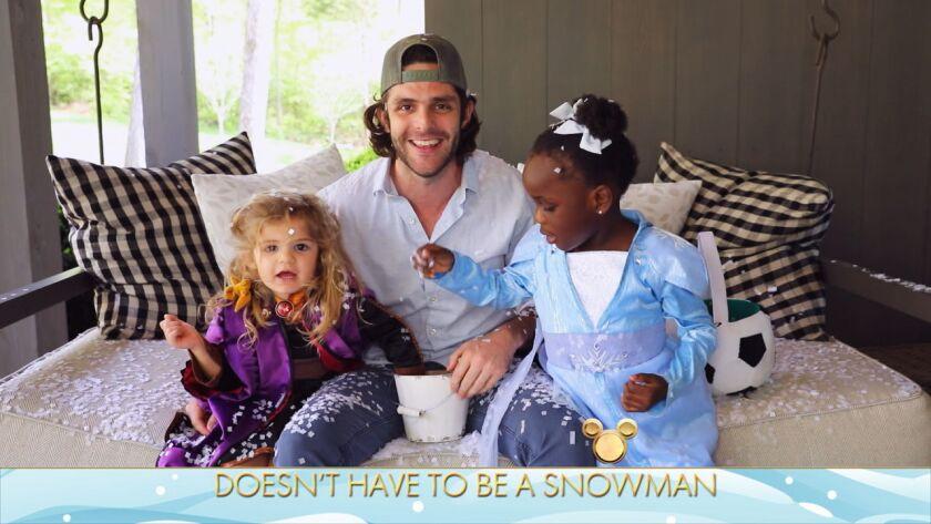 Thomas Rhett with daughters Ada and Willa