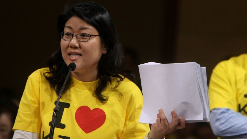 Korean American lawyer and activist Grace Yoo protests a gerrymandering of Los Angeles City Council districts that diluted Koreatown's political voice in 2012. Yoo later ran for a council seat and lost to incumbent Herb Wesson.