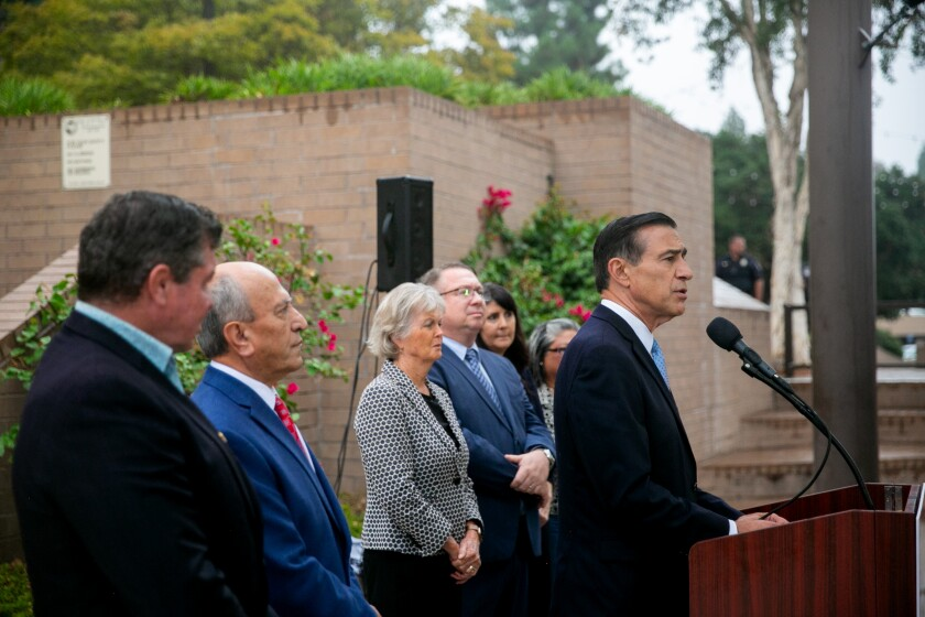 Former Rep. Darrell Issa announces his candidacy for the 50th Congressional District on Thursday with support from (left to right) retired Navy SEAL Larry Wilske, former Escondido Mayor Sam Abed, county Supervisor Dianne Jacob and El Cajon Mayor Bill Wells.