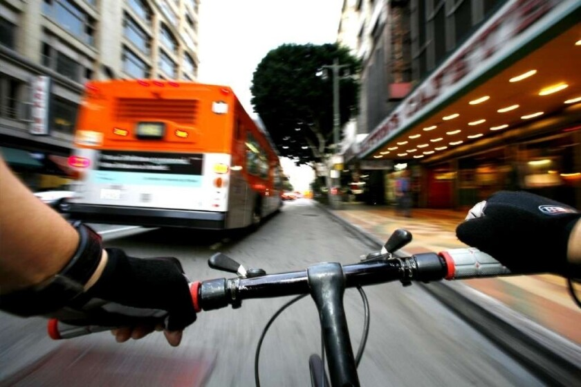 A bicyclist's perspective navigating street traffic in downtown Los Angeles in 2009.
