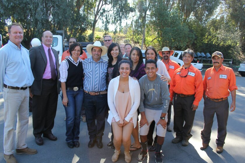 Thirty-two-year Rancho Santa Fe Association employee Olimpio Rodriguez (in cowboy hat and blue shirt) was honored with a retirement celebration on Feb. 13.