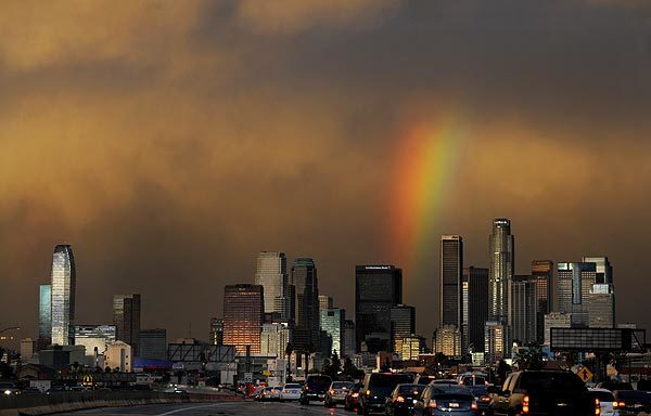 A rainbow brightens an otherwise gloomy scene in downtown Los Angeles.