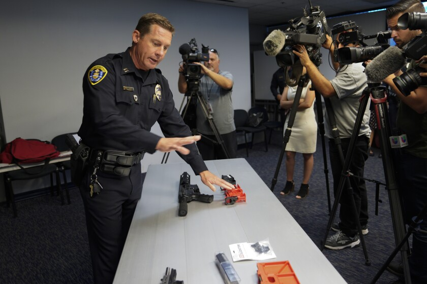 """At San Diego Police Department Headquarters on July 14, Capt. Matt Novak points out a confiscated """"ghost rifle."""""""