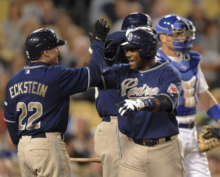 Miguel Tejada celebrates his two-run homer with teammate David Eckstein in the third inning