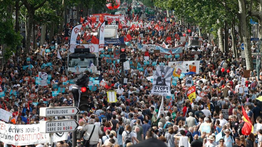 Protesters took to the streets of Paris on Saturday to denounce new government economic policies.