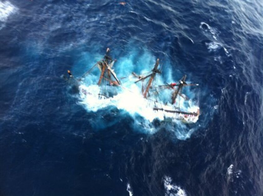 FILE - This undated file photo provided by the U.S. Coast Guard shows the HMS Bounty, a 180-foot sailboat, submerged in the Atlantic Ocean during Hurricane Sandy approximately 90 miles southeast of Hatteras, N.C., Monday, Oct. 29, 2012. Surviving crew members will testify as a federal safety panel