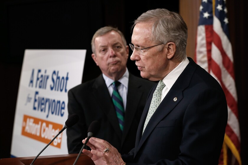 Senate Majority Leader Harry Reid (D-Nev.) and Sen. Richard Durbin (D-Ill.) speak at a news conference at the U.S. Capitol.