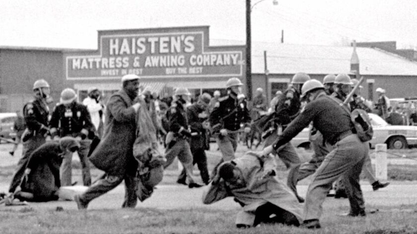 Alabama state troopers beat voting rights marchers, including John Lewis, front right, in Selma on March 7, 1965.