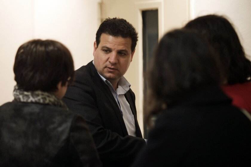 Ayman Odeh, head of the Joint List, an alliance of four small Arab-backed parties running in the upcoming Israeli elections, talks to voters March 2 in Jerusalem.