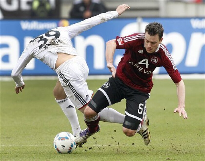 Nuremberg's Hanno Balitsch, right, and Munich's Toni Kroos challenge for the ball during the German first division Bundesliga soccer match between 1.FC Nuremberg and Bayern Munich in Nuremberg, Germany, Saturday, March 31, 2012. (AP Photo/Michael Probst) NO MOBILE USE UNTIL 2 HOURS AFTER THE MATCH,