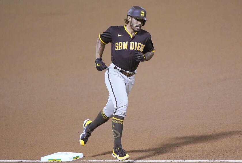 Padres rookie Luis Campusano rounds the bases after hitting his first major league home run Friday in Oakland.