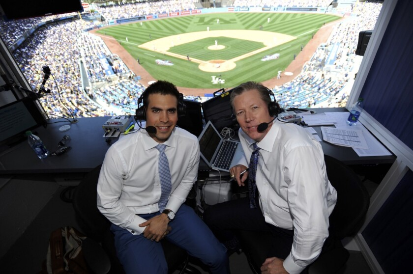 Dodgers broadcasters Joe Davis and Orel Hershiser on opening day at Dodger Stadium in 2017.