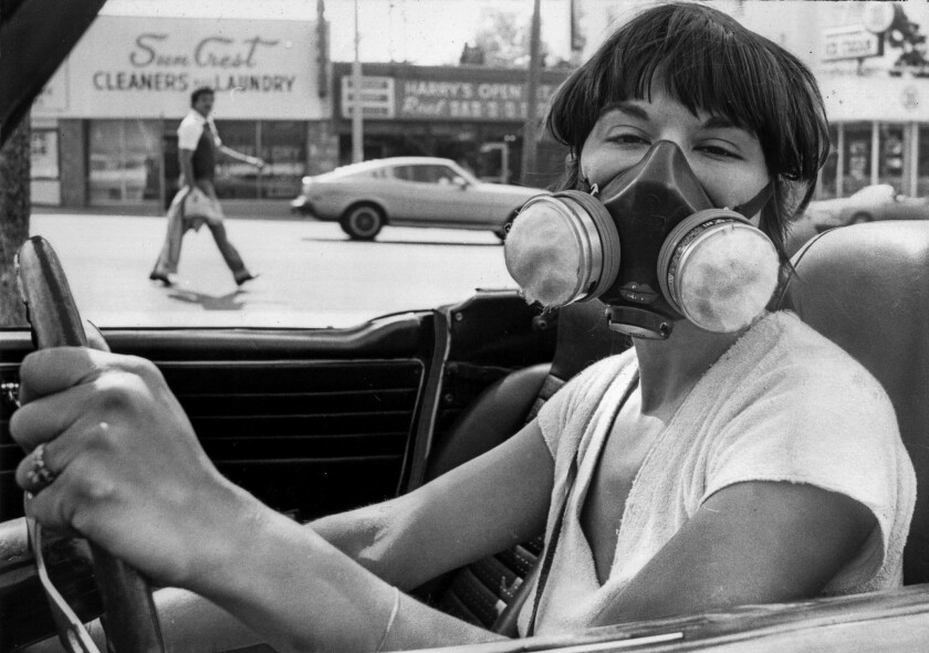 June 29, 1979: Sera Segal-Alsberg wears mask designed to filter out airborne particles during Los An