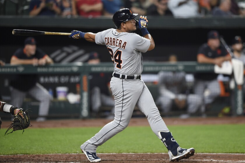 Detroit Tigers' Miguel Cabrera follows through on his 499th career home run, during the fifth inning of the team's baseball game against the Baltimore Orioles, Wednesday, Aug. 11, 2021, in Baltimore.(AP Photo/Gail Burton)