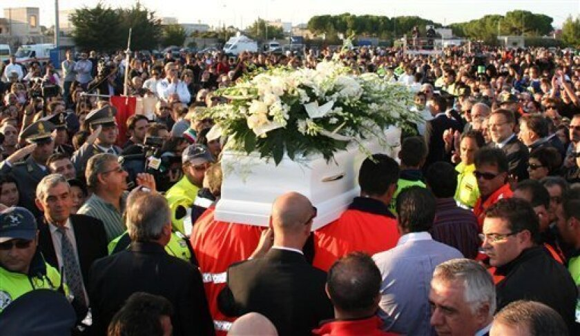The coffin of 15-year-old Sarah Scazzi is carried through the crowd during her funeral in Avetrana, Italy, Saturday, Oct. 9, 2010. Thousands of people have walked past the coffin of a 15-year-old girl whose killing, announced to her mother on live TV, has shocked Italy. Sarah Scazzi disappeared Aug. 26 while walking in the town of Avetrana, in southern Italy. She remained missing for weeks while police searched for clues. The girl's mother, Concetta Serrano, was a guest on a live TV show Wednesday when she was told her daughter was likely dead and her brother-in-law had allegedly killed her. (AP Photo/Donato Fasano)