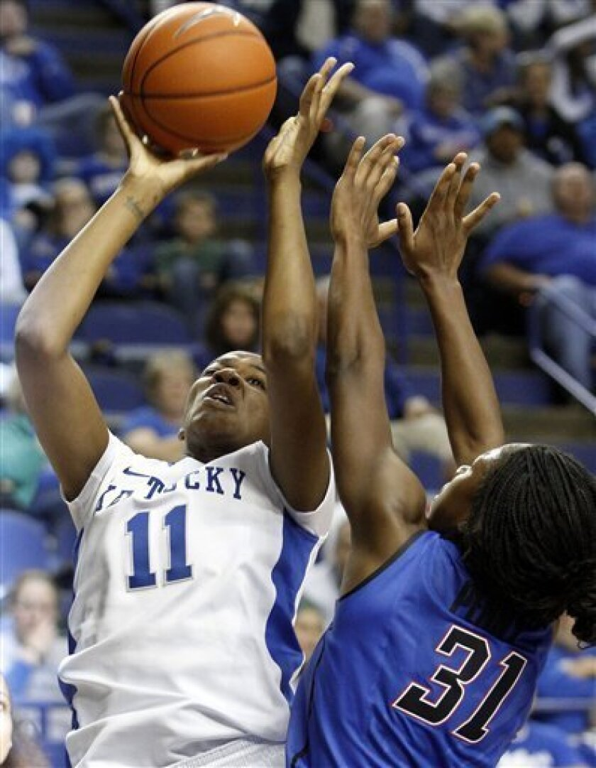 CORRECTS DATE - Kentucky's DeNesha Stallworth (11) shoots under pressure from DePaul's Jasmine Penny during the first half of an NCAA college basketball game at Rupp Arena in Lexington, Ky., Friday, Dec. 7, 2012. (AP Photo/James Crisp)