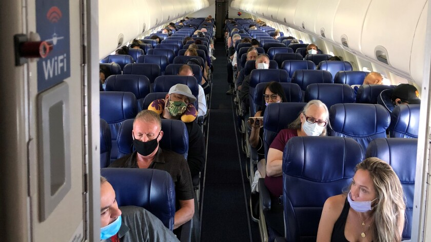 Masked passengers fill a Southwest Airlines flight from Burbank to Las Vegas on June 3, with middle seats left open.