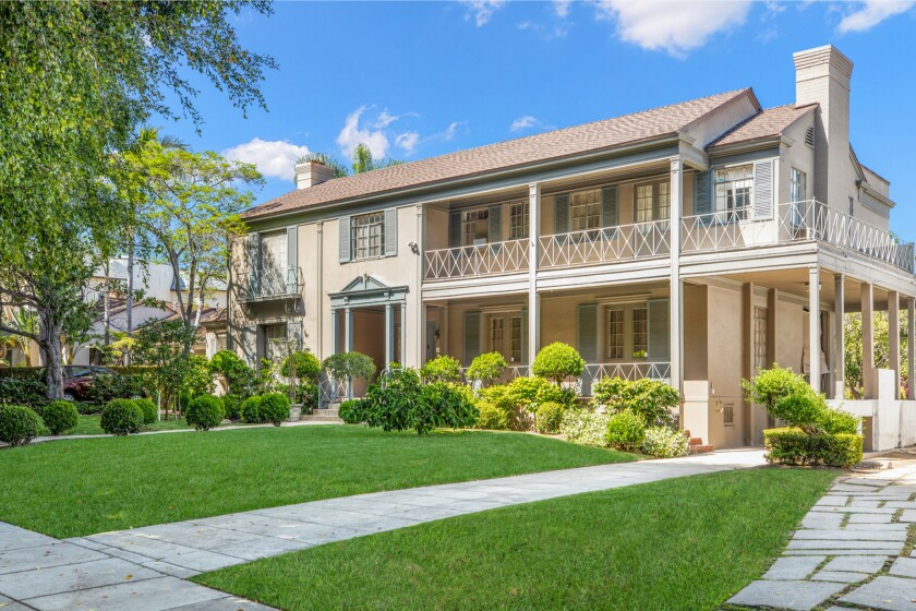 The two side-by-side estates include a 1930s Traditional-style home and 1920s Spanish-style home.