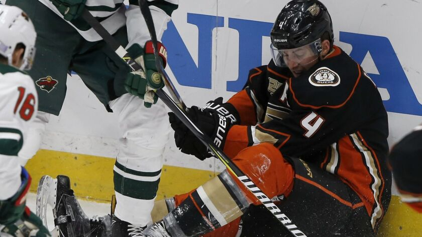 Ducks defenseman Cam Fowler fights for the puck against the Minnesota Wild during the third period on Friday.