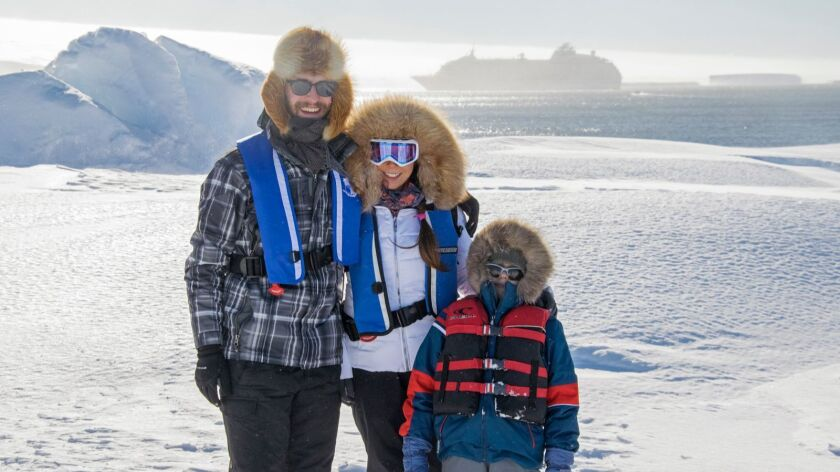 Alex Myers, left, with his wife Daria Myers and stepson Nikolai Peterson, photographed in Antarctica earlier this year.