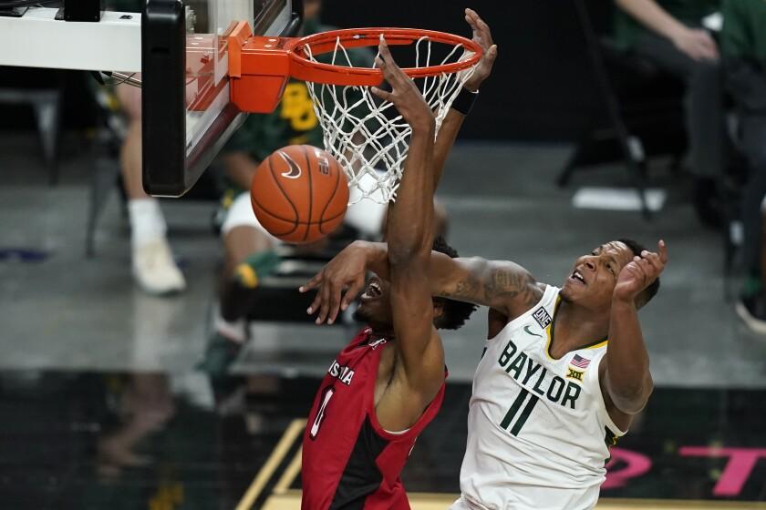 Baylor's Mark Vital (11) fouls Louisiana-Lafayette's Theo Akwuba during the first half of an NCAA college basketball game Saturday, Nov. 28, 2020, in Las Vegas. (AP Photo/John Locher)