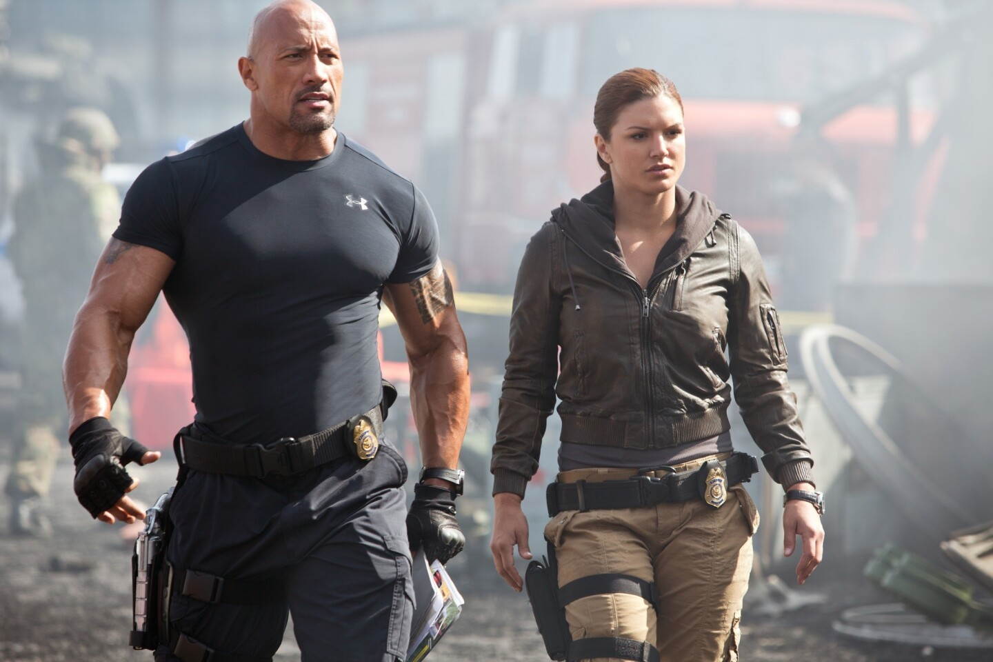 """Hobbs (Dwayne Johnson) and Riley (Gina Carano) lead their strike team in """"Fast & Furious 6."""""""