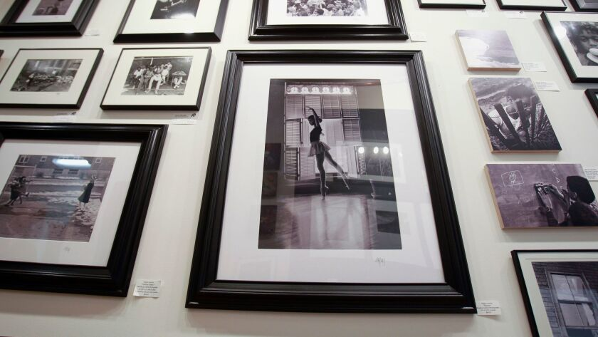 The photos of photographer and educator Major Morris on the wall at Distinction Gallery in Escondido.