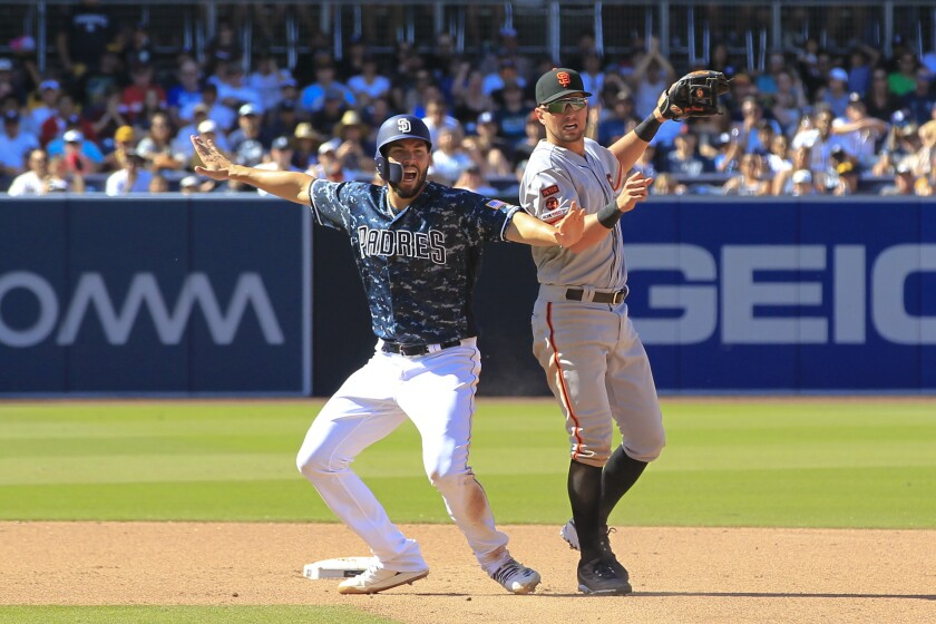 Eric Hosmer reacts after Manny Machado's grounder scored Hunter Renfroe with the go-ahead run in the seventh inning of the Padres' 3-1 victory over the Giants on Sunday.