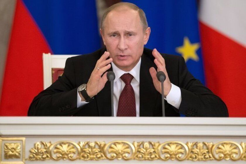 Russian President Vladimir Putin speaks during a news conference with French President Francois Hollande at the Kremlin in Moscow.