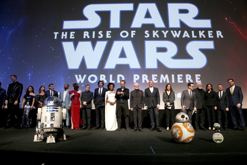 Cast and creators of 'Star Wars: The Rise of Skywalker' stand onstage before the world premiere audience in Hollywood.
