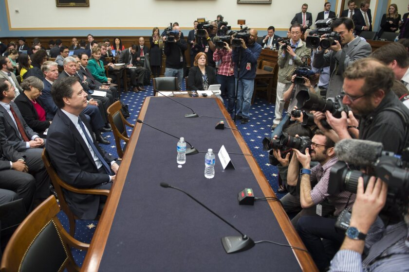 FBI Director James Comey, left, prepares to testify before Congress on Tuesday about the issues in his encryption fight with Apple.