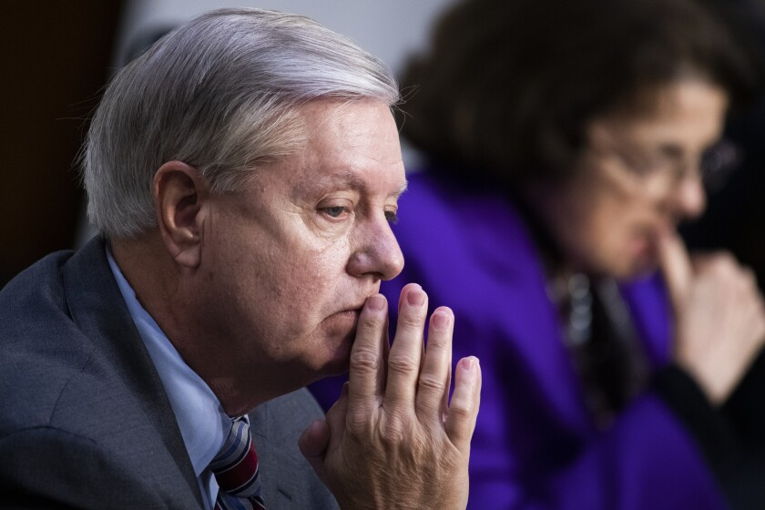 Sen. Lindsey Graham, R-S.C., listens during the confirmation hearing for Supreme Court nominee Amy Coney Barrett, before the Senate Judiciary Committee, Thursday, Oct. 15, 2020, on Capitol Hill in Washington. (Tom Williams/Pool via AP)