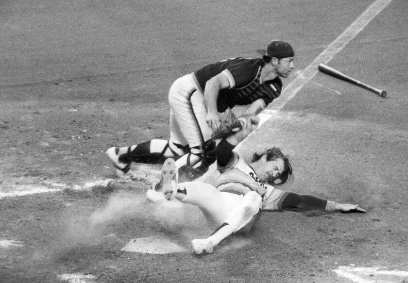 Padres catcher Gene Tenace makes the tag on Houston Astros first baseman Denny Walling in 1980 game.
