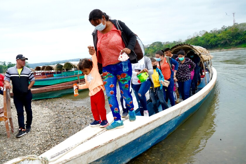 U.S.-bound Central American migrants arriving on the Mexican side of the Usumacinta River.