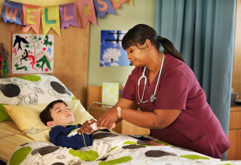 """Griffin Gluck and Octavia Spencer in """"Red Band Society."""""""