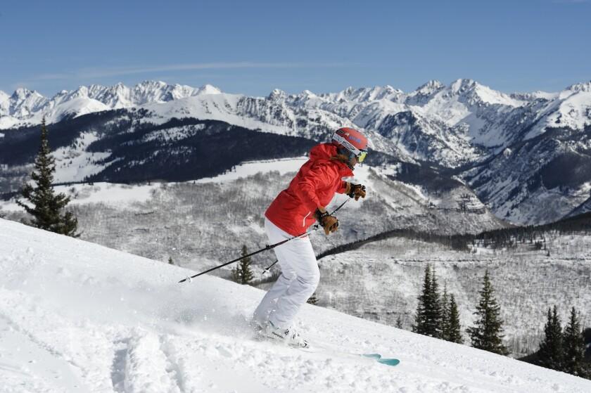 A skier makes tracks down a run at the Vail Resort