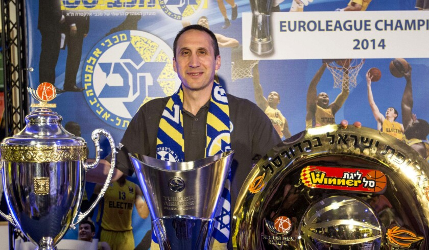 New Cavaliers Coach David Blatt poses with some of the trophies he won with Maccabi Tel Aviv at a news conference in Israel announcing his departure from the club for the NBA.