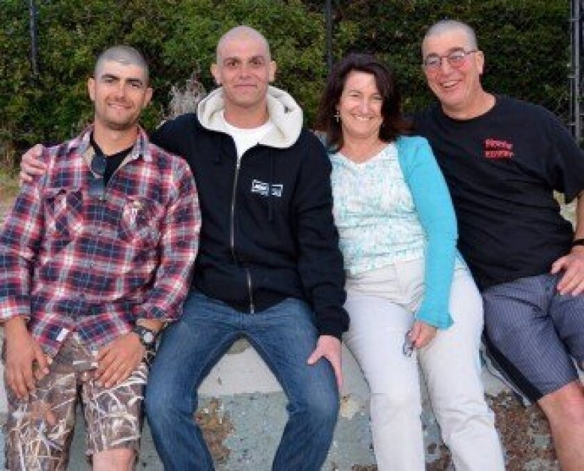 Dan Williams (second from left) with his younger brother, Jesse (left), mom, Jane, and dad, Will, at his 29th birthday (after shaving their heads in support of his treatment). Courtesy photo