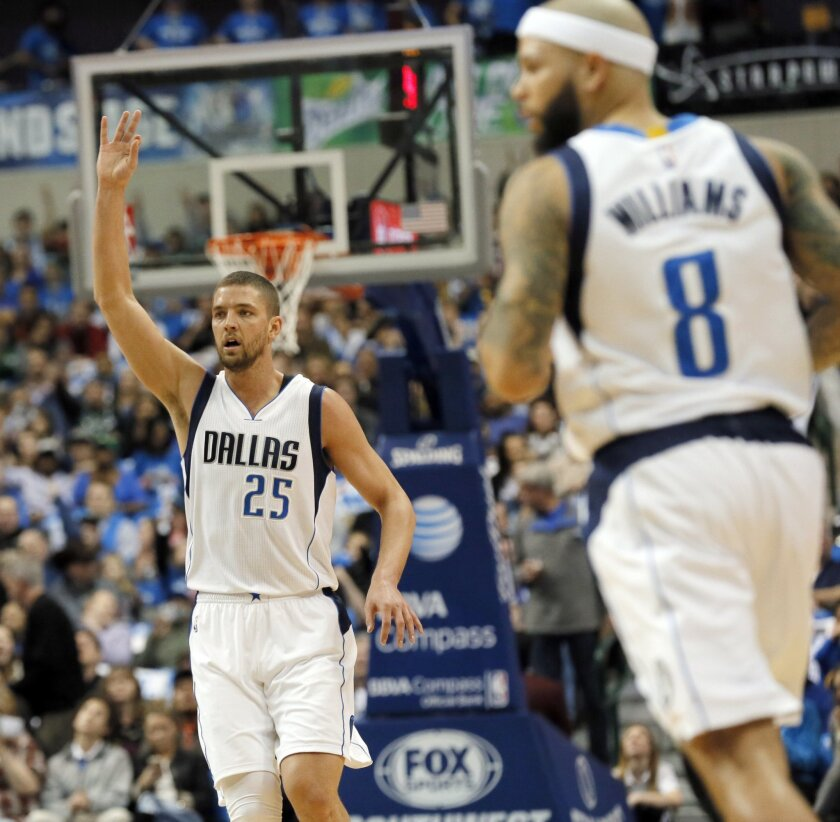 Dallas Mavericks' Chandler Parsons (25) celebrates sinking a 3-point basket as Deron Williams (8) watches in the first half of an NBA basketball game against the Utah Jazz onTuesday, Feb. 9, 2016, in Dallas. (AP Photo/Tony Gutierrez)