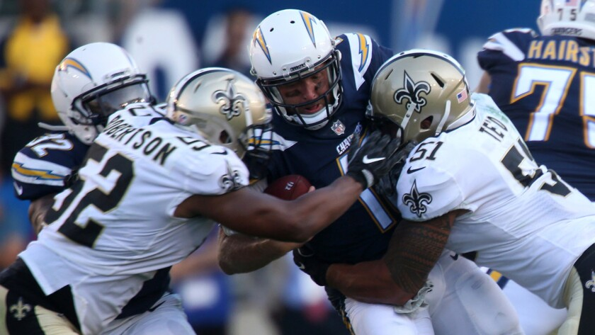 Chargers quarterback Kellen Clemens is sacked by Saints linebacker Manti Te'o, right, and linebacker Craig Robertson during second quarter action.