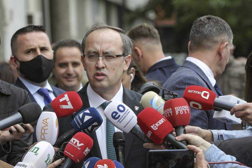Newly elected prime minister Avdullah Hoti, speaks to the media in the capital Pristina, Wednesday, June 3, 2020. Kosovo's parliament voted in a new prime minister Wednesday to lead a fragile coalition government that will inherit the economic impact of the coronavirus pandemic and stalled normalization talks with neighboring Serbia. (AP Photo/Visar Kryeziu)