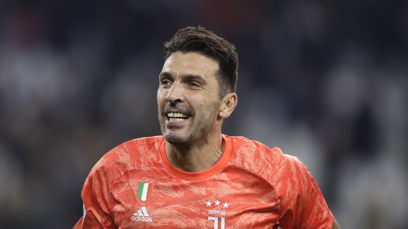 FILE -- In this Oct.19, 2019 file photo Juventus' goalkeeper Gianluigi Buffon celebrates at the end of a Serie A soccer match between Juventus and Bologna, at the Allianz stadium in Turin, Italy. Buffon rejoined Serie B club Parma on Thursday, June 17, 2021, more than a quarter century after beginning his legendary Serie A career with the club. (AP Photo/Luca Bruno)