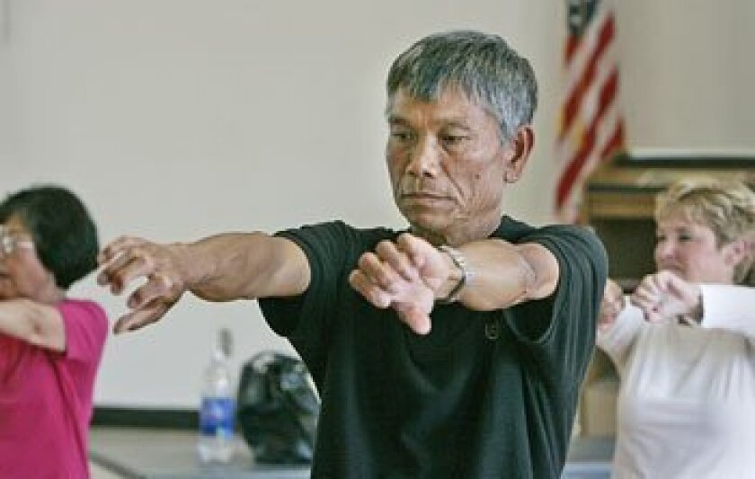 Chieu Hoang (center) and others did warm-up exercises in tai chi class at Bayside Community Center. The center has struggled to maintain its wide menu of programs. (Peggy Peattie / Union-Tribune)