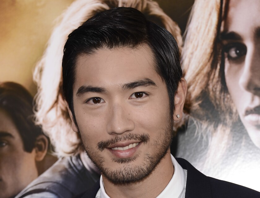 """Godfrey Gao arrives at the world premiere of """"The Mortal Instruments: City of Bones"""" on Aug. 12, 2013, at the ArcLight Cinerama Dome in Los Angeles."""