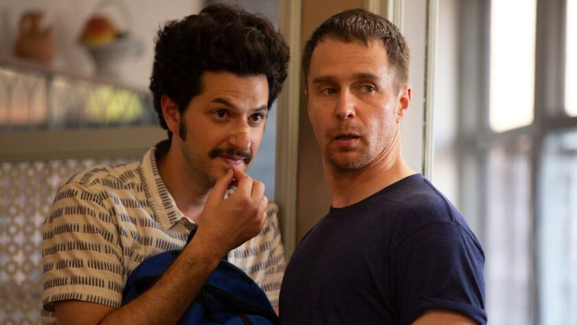 "(L-R) - Ben Schwartz and Sam Rockwell in a scene from ""Blue Iguana."" Credit: Screen Media Films"