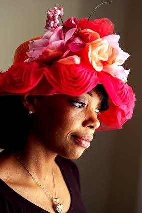 Though the world has gotten much more casual in recent decades, and hats are far less ubiquitous, hat culture remains alive and well in many of the nation's black churches. These 'church crowns' are about devotion with a touch of something delightful, and wearing them takes a bundle of attitude and self-esteem. Meeka Robinson-Davis, pictured in a red chapeau decorated with red, pink and yellow flowers, is a second-generation hat maker. She runs the Slauson Avenue branch of the store her mother Sonja Robinson founded, One-of-a-Kind Hats on Crenshaw Boulevard in Los Angeles.