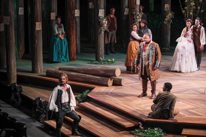 """Mark H. Dold (left) as Jaques, Cornell Womack as Duke Senior and the cast of the Old Globe's """"As You Like It."""""""