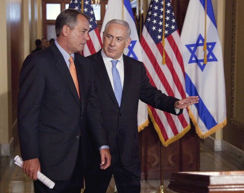 Israeli Prime Minister Benjamin Netanyahu walks with House Speaker John Boehner to make a statement in Washington in May 2011. Boehner has invited Netanyahu to Capitol Hill again.