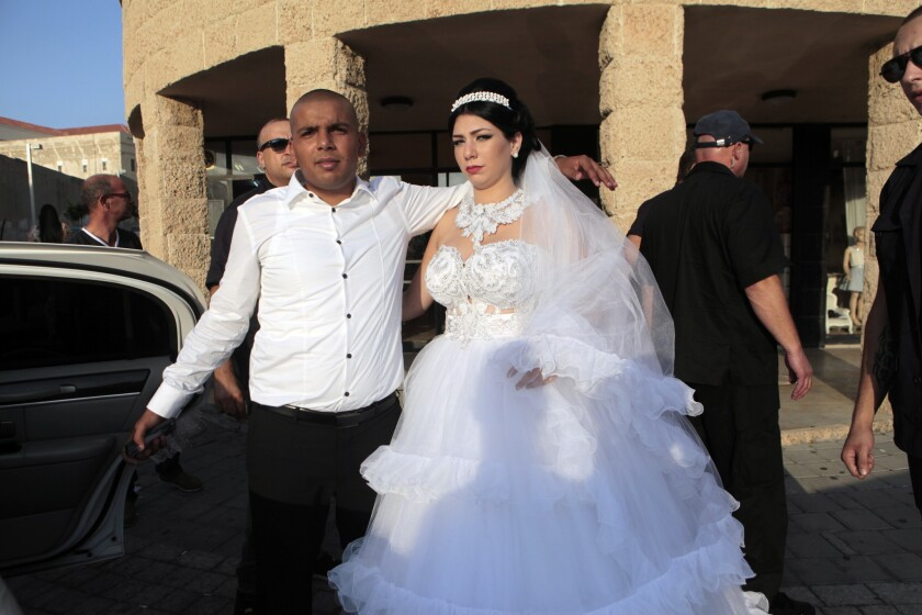 Mahmoud Mansour, left, a Muslim Arab from Jaffa, and Morel Malka, a Jewish Israeli who converted to Islam, are shown Sunday on their wedding day.
